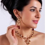 Sharnam Art Gold lacquered necklace with maroon beads decorated with sparkling stones For Women @ Rs 199